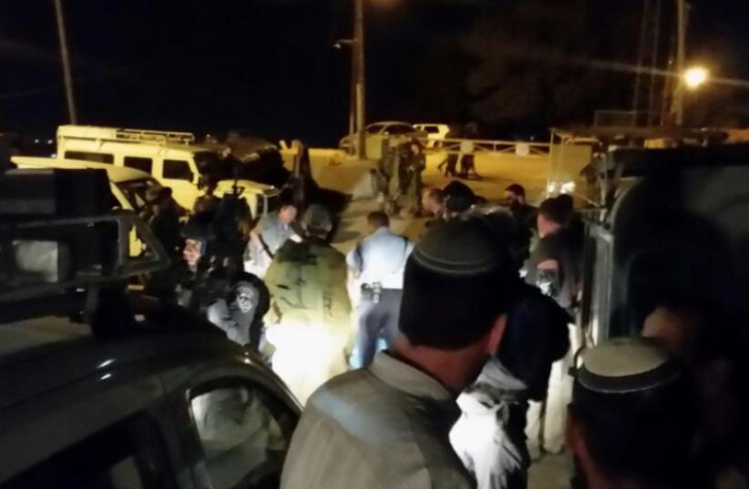Scene of stabbing attack in Hebron, December 4, 2015. (photo credit: UNITED HATZALAH)