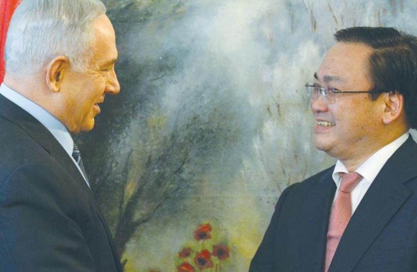PRIME MINISTER Benjamin Netanyahu greets Vietnamese Deputy Prime Minister Hoang Trung Hai at the Knesset this week. (photo credit: KOBI GIDEON/GPO)