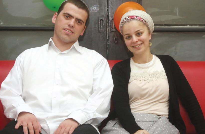 SARAH-TEHIYA and Ariel Biegel. OneFamily has given the couple money for a new apartment in Geva Binyamin. (photo credit: MARC ISRAEL SELLEM/THE JERUSALEM POST)