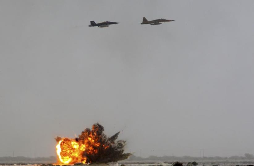 Iranian air force fighter planes drop bombs on targets during manoeuvres in southern Iran June 24, 2009. (photo credit: FARS)