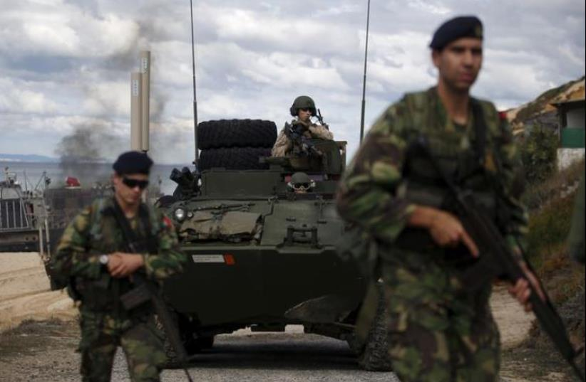 NATO soldiers attend a NATO military exercise. (photo credit: REUTERS)
