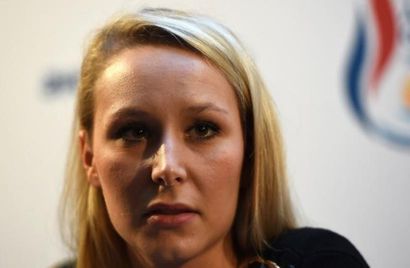 Vice-President of the French far-right Front National (FN) party and candidate for the regional elections in the Provence-Alpes-Cote d'Azur (PACA) region, Marion Marechal Le Pen, answers journalists' questions during a press conference (photo credit: AFP PHOTO)