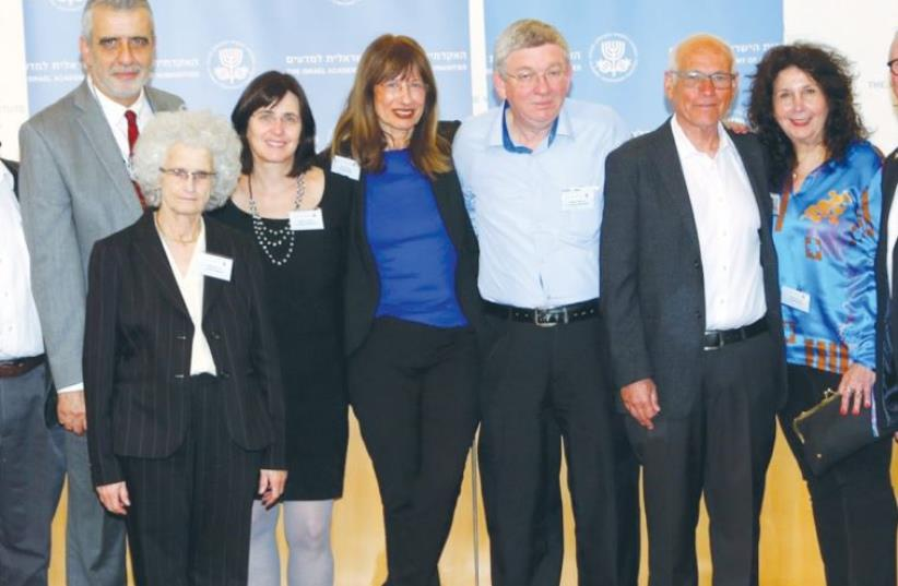 Nili Cohen (fifth from right), president of the Israel Academy of Sciences and Humanities is surrounded by inductees into the academy (photo credit: SASSON TIRAM)