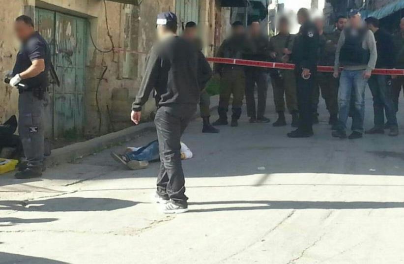 Scene of stabbing attack in Hebron  (photo credit: ELYASHIV TZVIEL)