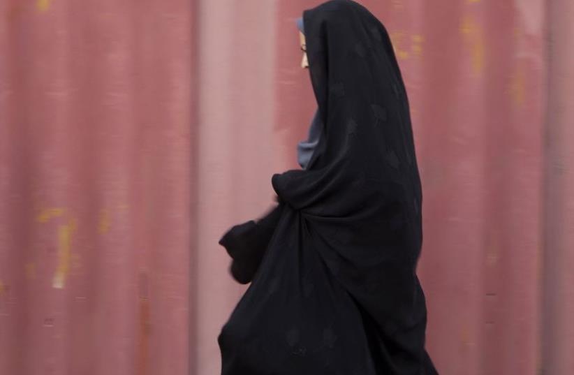 A woman in Iran [Illustrative] (photo credit: REUTERS)