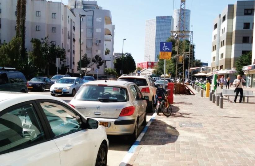 Cars line a Jerusalem street (photo credit: HABATLAN PR)