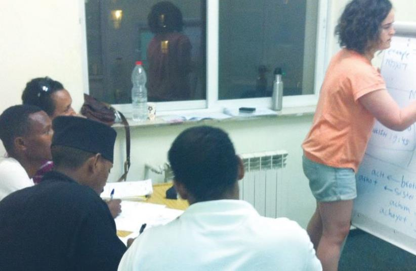 A Hebrew teacher conducts a class for asylum-seekers recently at the Jerusalem African Community Center (photo credit: Courtesy)