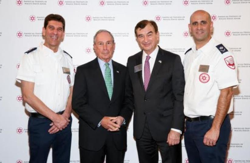MDA Director-General Eli Bin (left), former New York City Mayor Michael R. Bloomberg (second from left), AFMDA Chairman Mark Lebow (second from right), and MDA Director of Operations Alon Fridman (right) at the 2015 AFMDA Annual Red Star Gala in New York on December 2.  (photo credit: MICHAEL PRIEST PHOTOGRAPHY)