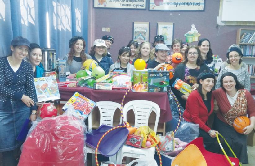 ISRAELI VOLUNTEERS display a toy-filled tranquility room they have donated to the AMIT HaRoeah elementary school in Sderot to help children there overcome trauma from rocket attacks. (photo credit: Courtesy)