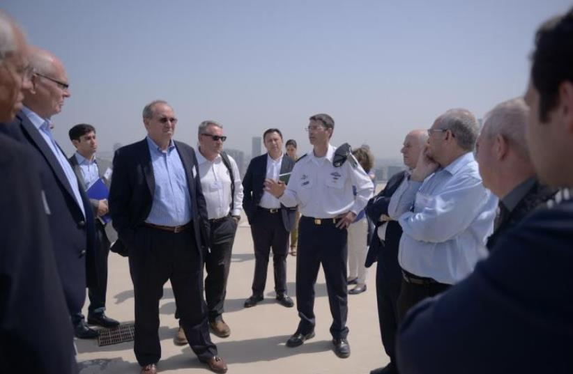 Members of the High Level Military Group speak to an Israel Navy officer during a fact-finding mission this year (photo credit: Courtesy)