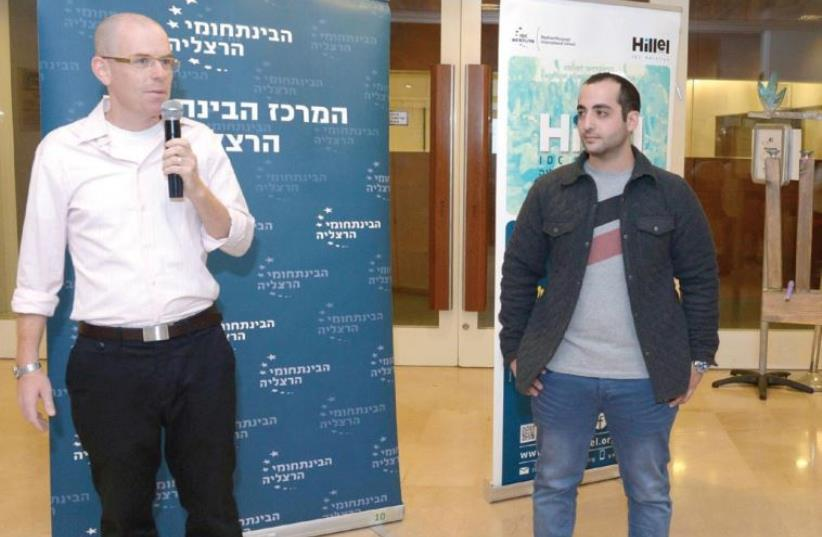 RECANATI INTERNATIONAL School student Amit Rose (right) was honored at a special hanukkia candle-lighting ceremony in Herzliya Thursday night. Also pictured is Hillel Israel CEO Alon Friedman. (photo credit: MARK NEYMAN)