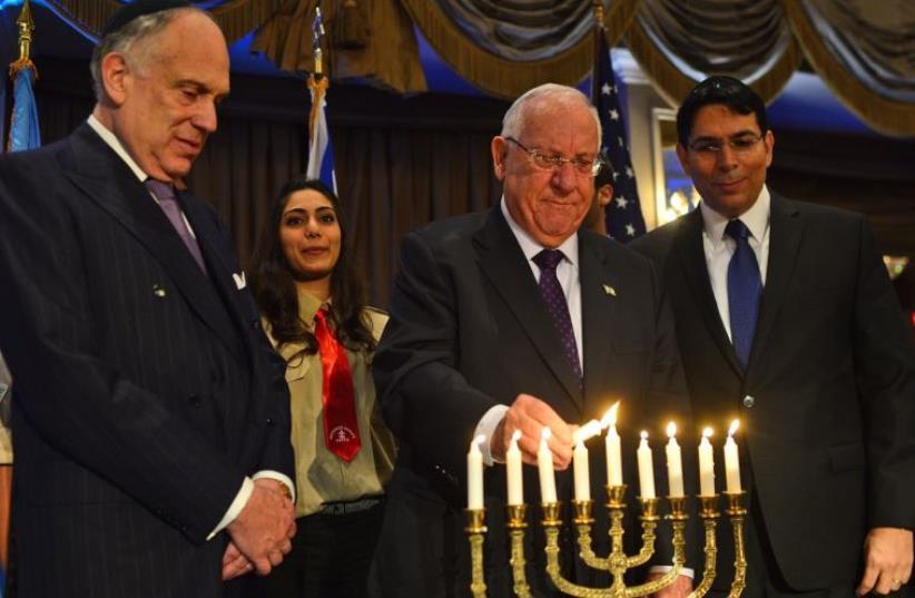 Reuven Rivlin lights 8th Hanukka candle with Danny Danon and Ronald Lauder (photo credit: KOBI GIDEON/GPO)