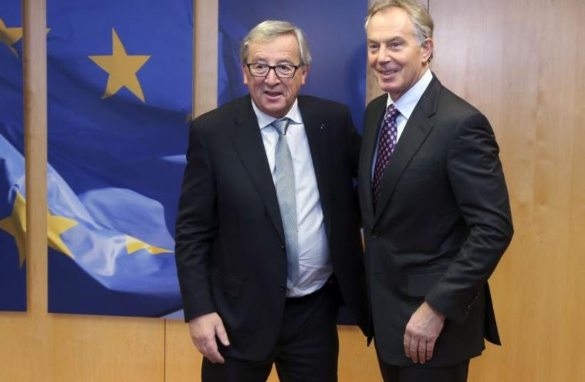 European Commission President Jean-Claude Juncker poses with Quartet Representative to the Middle East and former British Prime Minister Tony Blair (R) (photo credit: REUTERS)