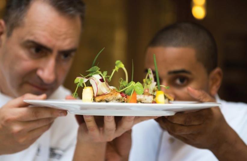 Chefs Itzik Mizrahi Barak and Joseph JJ Johnson with their creation. (photo credit: SARKA BABICKA)
