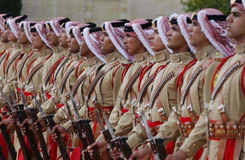 An honor guard marches at the Royal Palace in Amman, Jordan (photo credit: REUTERS)