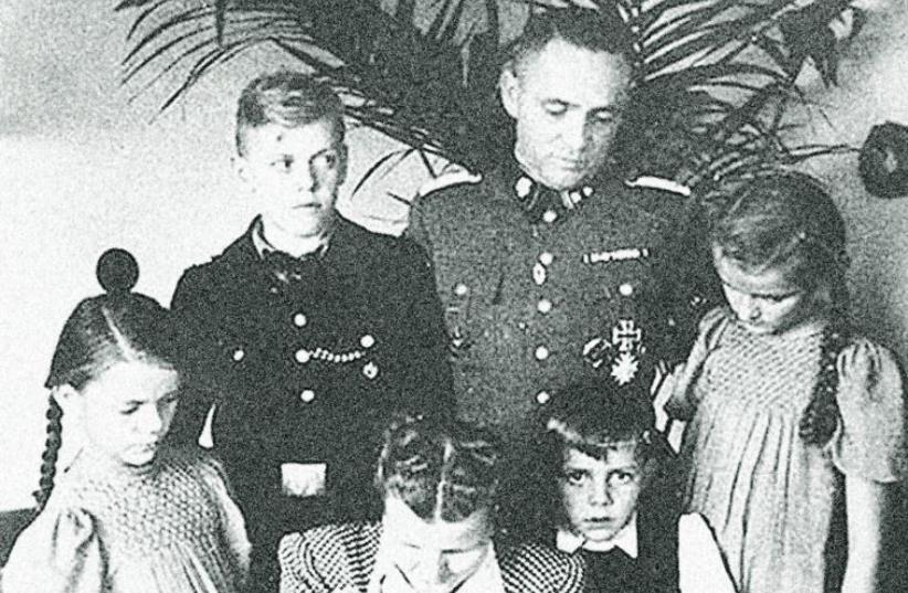 THE HÖSS family (from left to right) Ingebrigitt; Klaus; Rudolf's wife Hedwig, holding Annegret; Rudolf Hoess, Hans- Rudolf (Rainer's father); and Heidetraut. (photo credit: COURTESY RAINER HOSS)