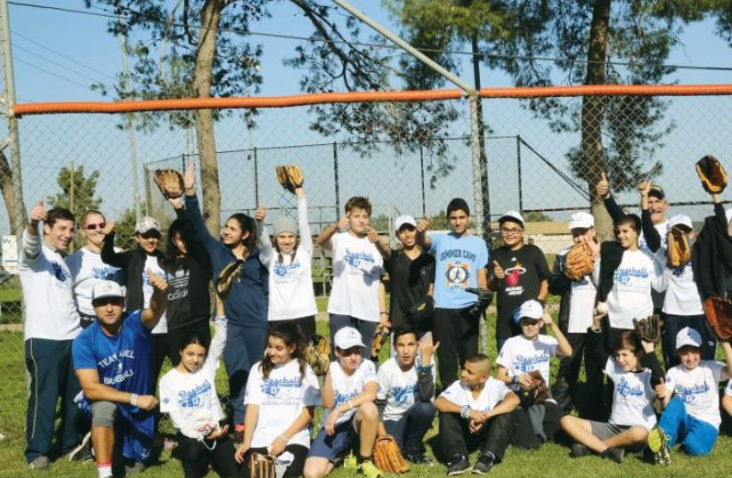 THE BASEBALL LE'KULAM program brings together Arab and Jewish youths who learn to play baseball thanks to the organizers, Play Global, Israel Association of Baseball and JNF. (photo credit: YOSSI ZAMIR)