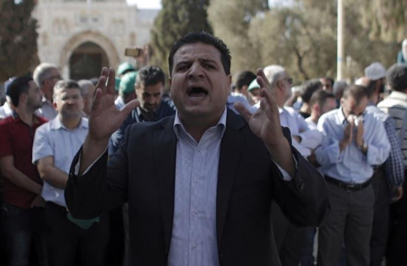 Joint List head Ayman Odeh shouts slogans near the Dome of the Rock in Jerusalem (photo credit: AFP PHOTO)