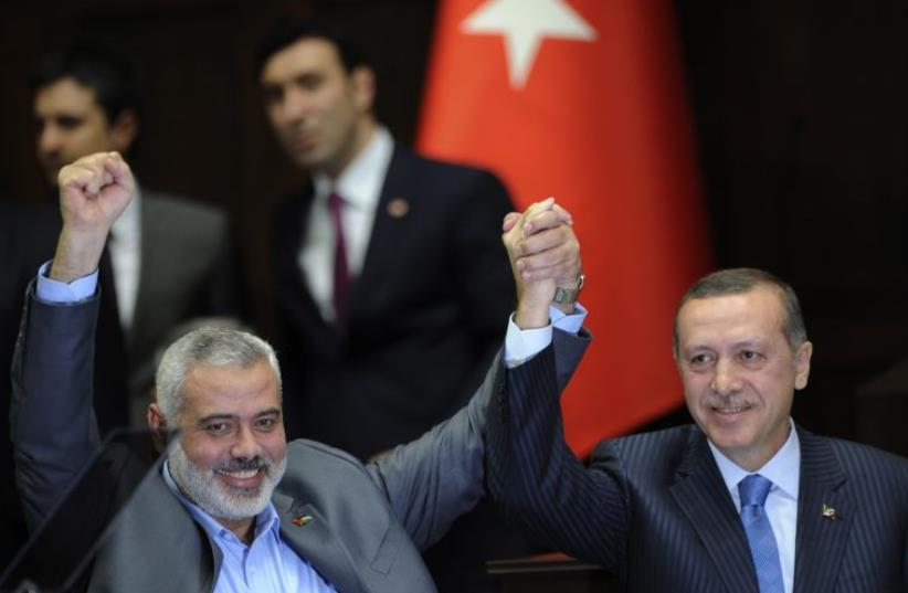 Turkey's President Recep Tayyip Erdogan (R) and Hamas leader Ismail Haniyeh seen in Ankara on January 3, 2012  (photo credit: REUTERS)