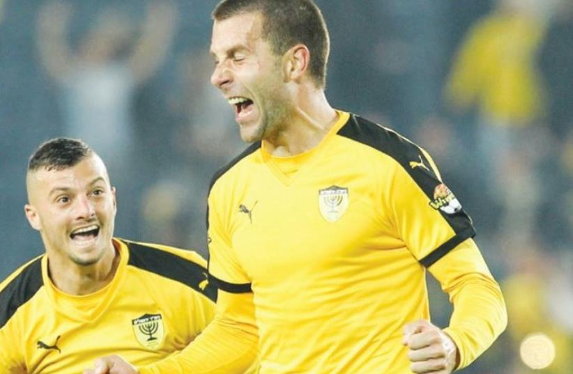 Beitar Jerusalem defender Dusan Matovic celebrates after scoring the winner a victory over Maccabi Netanya at Teddy Stadium (photo credit: DANNY MARON)