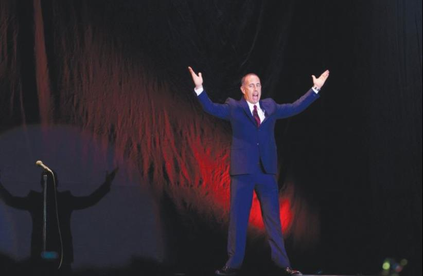 Jerry Seinfeld takes the stage for the first of his four shows in Tel Aviv (photo credit: MIRIAM ALSTER/FLASH90)