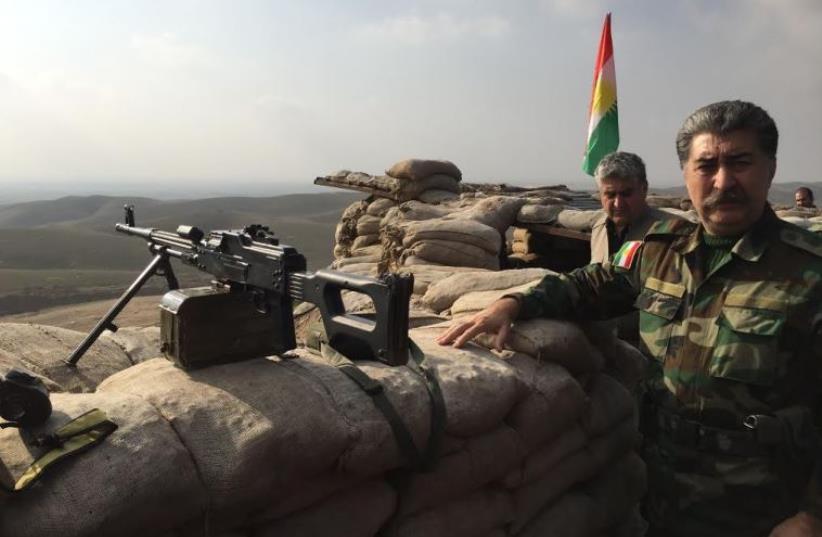 Hussein Yazdanpana, vice-president of the Kurdistan Freedom Party, speaking at the frontline with ISIS northeast of Kirkuk (photo credit: SETH J. FRANTZMAN)