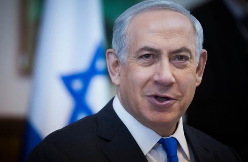 Netanyahu at cabinet meeting (photo credit: YONATAN SINDEL/POOL)