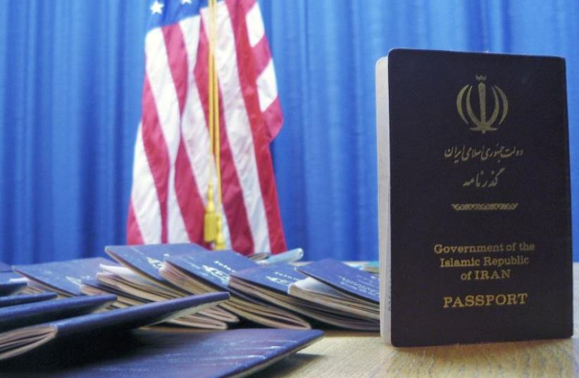 Iranian passports with U.S. visas are seen at the U.S. embassy in Bern, Switzerland, March 23, 2007 (photo credit: REUTERS)
