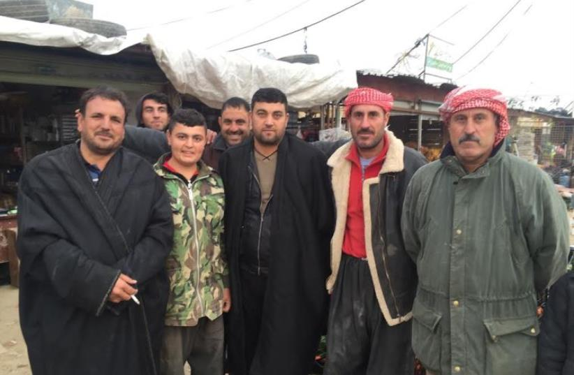 Yazidi men in Snune, one of the few villages some people returned to  (photo credit: SETH J. FRANTZMAN)
