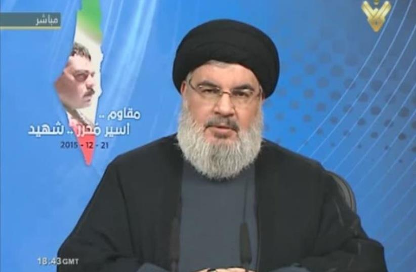 Hezbollah leader Hassan Nasrallah speaking on live television about the death of terrorist Samir Kuntar (photo credit: screenshot)