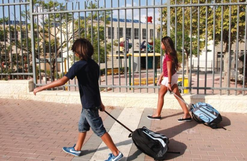 CHILD PEDESTRIANS from the age of seven to 10 had the most difficulty in identifying when it was safe to cross the road, researchers found (photo credit: MARC ISRAEL SELLEM/THE JERUSALEM POST)