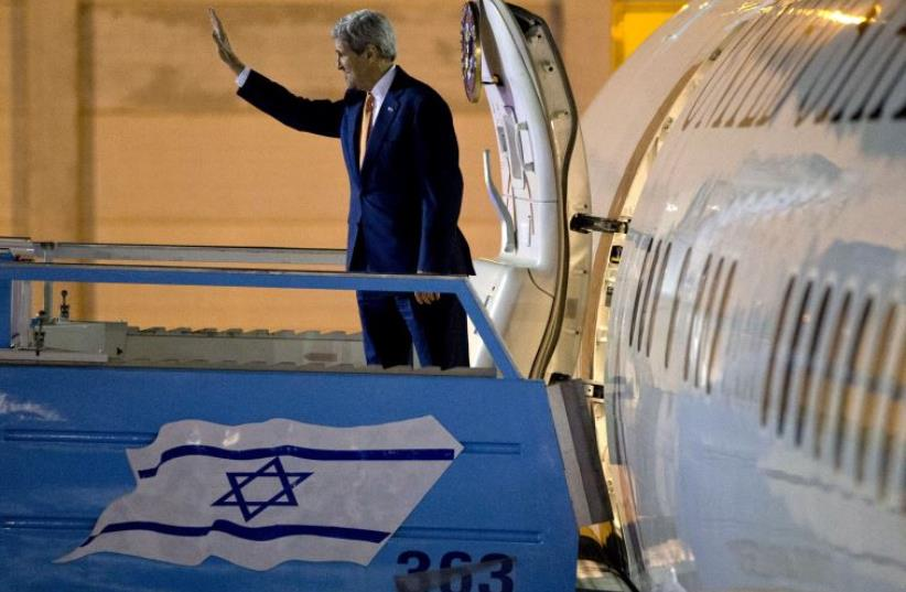 US Secretary of State John Kerry waves as he heads home after a visit to Israel and the Palestinian Authority, November 24 (photo credit: REUTERS)