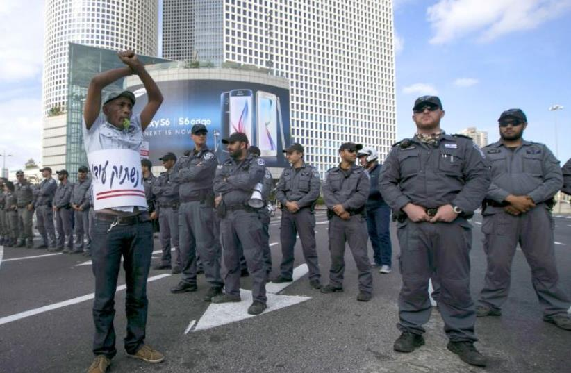 Israelis of Ethiopian origin demonstrated against police racism and brutality, May 3, after a video showing a policeman beating a soldier from the community went viral (photo credit: REUTERS)