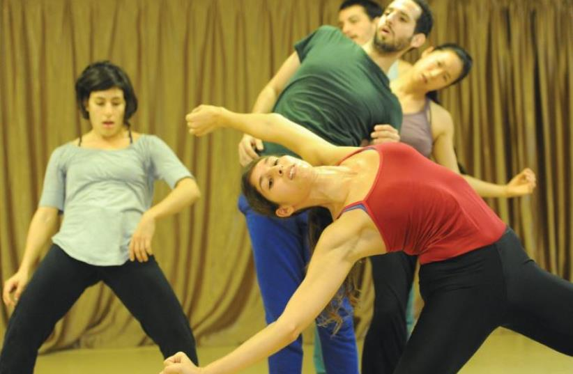 FOUR LOCAL dancers perform together with Japanese dancer Ema Yuasa in Idan Sharabi's 'Interviews/Makom.' (photo credit: TAMI WEISS)