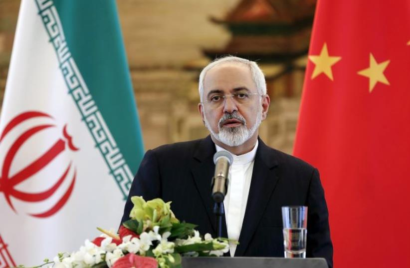 Iranian Foreign Minister Mohammad Javad Zarif at a news conference after meeting with Chinese Foreign Minister Wang Yi in Beijing (photo credit: REUTERS)