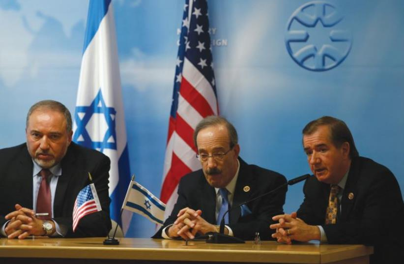Foreign Minister Avigdor Lieberman (L) sits with US Representative Eliot Engel (D-NY) (C) and House Foreign Affairs Chairman Ed Royce (R-CA) during their joint news conference in Jerusalem September 2, 2014 (photo credit: REUTERS)