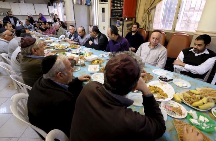 Iranian Jews pray at the Abrishami synagogue on Palestine Street in Tehran