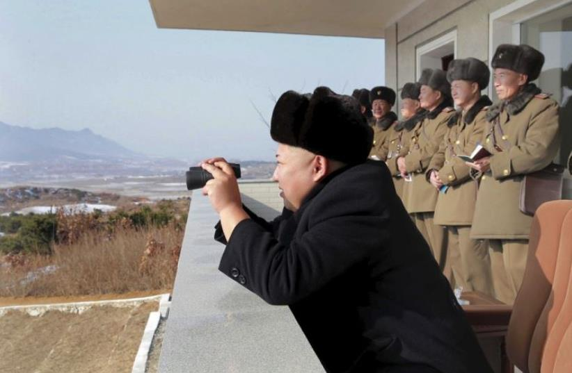 North Korean leader Kim Jong Un watches maneuvers between KPA large combined units 526 and 671 at undisclosed location in   this undated photo released by North Korea's Korean Central News Agency (photo credit: REUTERS)