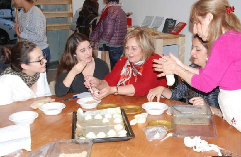 Baking cookies with the women of the Rameh Orthodox Christian Church. (photo credit: MEDIA LINE)