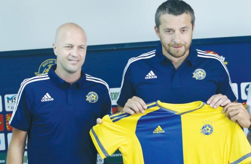 Slavisa Jokanovic (right) is introduced as Maccabi Tel Aviv's new head coach with sports director Jordi Cruyff sitting beside him (photo credit: ADI AVISHAI)