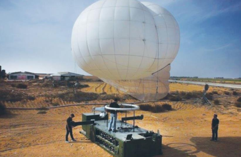 IDF SOLDIERS prepare to launch a Skystar 330 intelligence and counter-IED aerostat at a base somewhere in Israel recently (photo credit: RT LTA SYSTEMS LTD.)