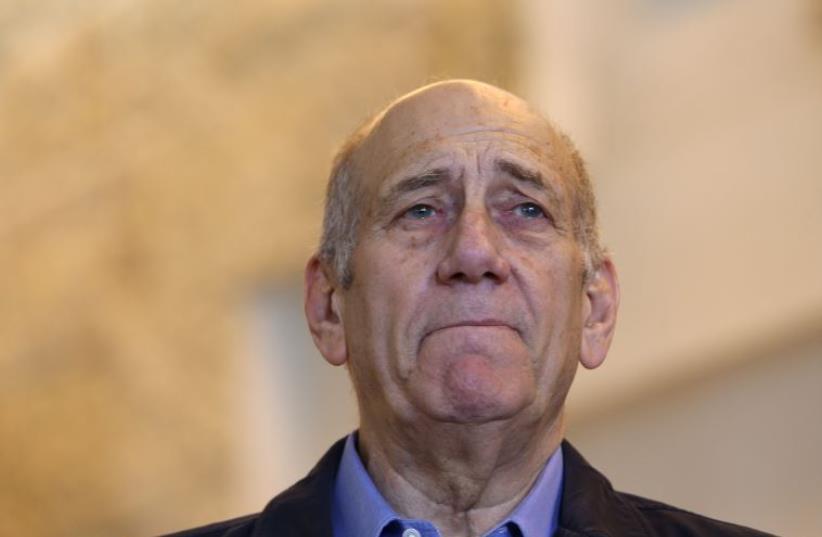 Former PM Ehud Olmert  (photo credit: AMIT SHABAY/POOL)