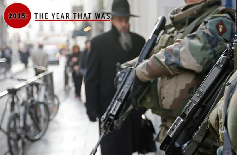 French soldiers patrol the street in a Jewish neighborhood near a religious school and a synagogue as part of the highest level of the 'Vigipirate' security plan put in place after the terrorist attacks in Paris (photo credit: REUTERS,JPOST STAFF)