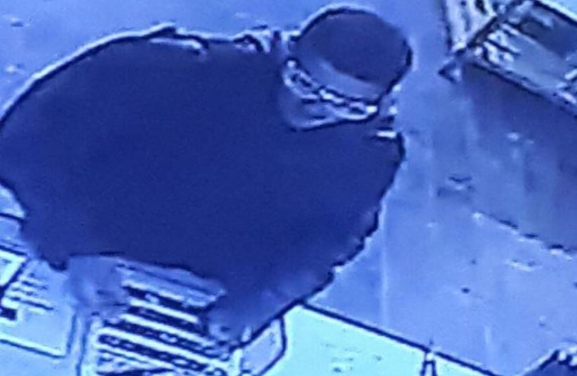The suspect is seen on closed-circuit television just moments before opening fire in Tel Aviv
