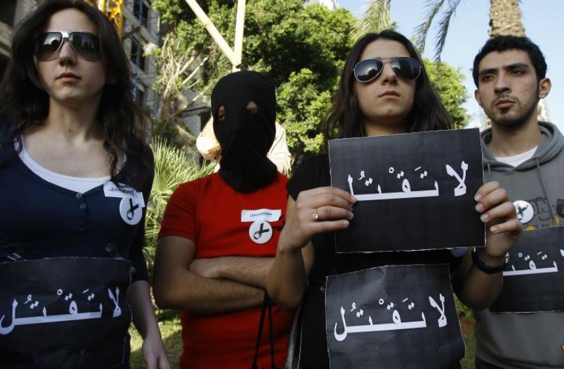 Human rights activists protest outside the Saudi embassy in Beirut against Saudi executions [File] (photo credit: ANWAR AMRO / AFP)