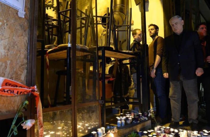 Prime Minister Benjamin Netanyahu at the scene of the shooting attack in Tel Aviv (photo credit: HAIM ZACH/GPO)