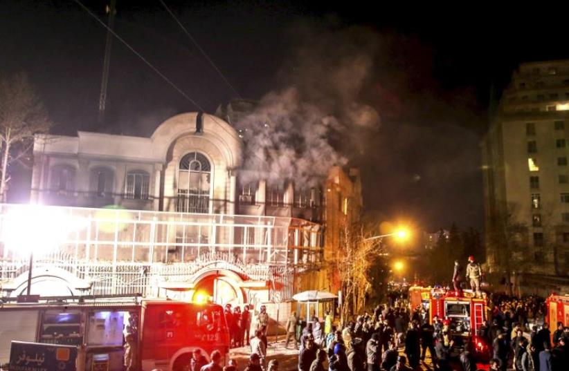 Flames rise from Saudi Arabia's embassy during a demonstration in Tehran January 2, 2016 (photo credit: REUTERS)