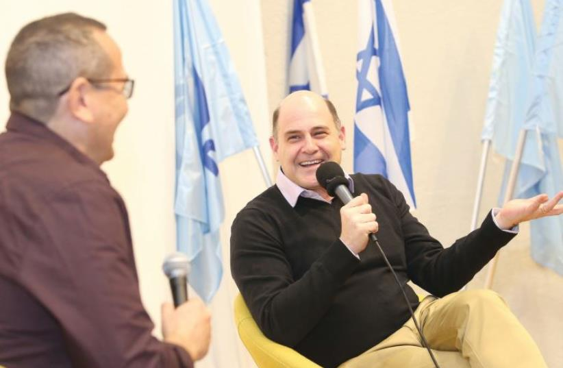 'I'M NOT a teacher. I don't have a message. But I do expect to elicit feeling from you... I want you to feel something,' says award-winning TV writer Matthew Weiner, seen here speaking at the Tel Aviv University. (photo credit: YAEL TZUR)