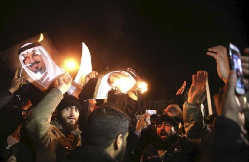 People protest in front of Saudi Arabia's embassy during a demonstration in Tehran January 2, 2016. Iranian protesters stormed the Saudi Embassy in Tehran early on Sunday morning as Shi'ite Muslim Iran reacted with fury to Saudi Arabia's execution of a prominent Shi'ite cleric. (photo credit: REUTERS)