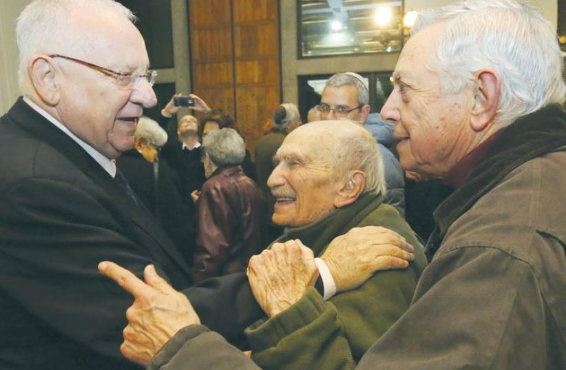 PRESIDENT REUVEN RIVLIN yesterday embraces Prof. Uzi Ornan, 93, who was his Hebrew teacher at the capital's Gymnasia Rehavia high school. (photo credit: YOSSI ZAMIR)